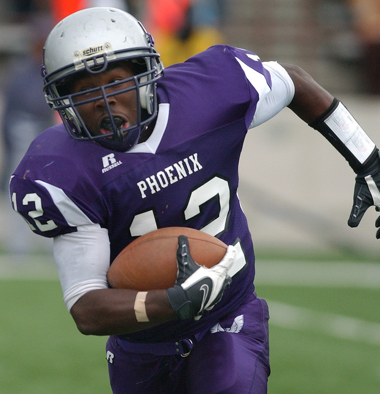 . Pontiac High School football player Jabari Martin runs for yardage against Auburn Hills Avondale during second quarter action.  Photo taken on Saturday, October 17, 2009, in a game played at Wisner Stadium in Pontiac, Mich.  (The Oakland Press/Jose Juarez)