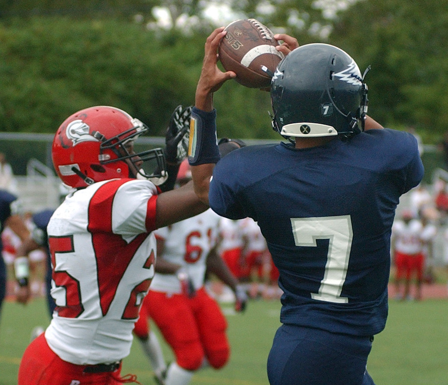 . Southfield High School football player Tre Walton, right, hauls in a reception in front of Oak Park defender Aston Gray, during first quarter action.  Photo taken on Friday, September 10, 2010, in a game played at Southfield HS in Southfield, Mich.  (The Oakland Press/Jose Juarez)