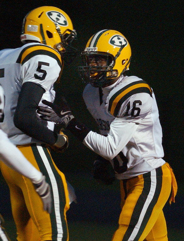 . Farmington Hills Harrison High School football player Aaron Burbridge, right, celebrates his touchdown run with teammate David Evans, during first quarter action against Rochester Adams, Friday, October 9, 2009, at Adams HS in Rochester Hills, Mich.  (The Oakland Press/Jose Juarez)