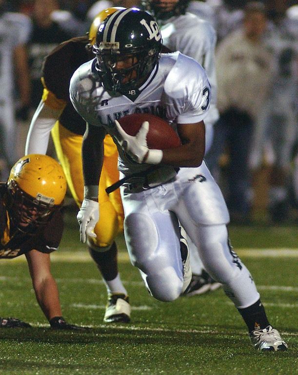 . Lake Orion High School football player Marques Stevenson runs for yardage against Rochester Adams during first quarter action, Friday, October 17, 2008, in a game played at Rochester Adams HS in Rochester Hills, Mich.  (The Oakland Press/Jose Juarez)