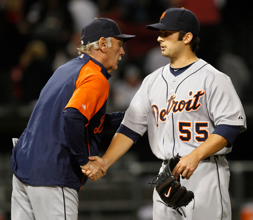 . Detroit Tigers manager Jim Leyland, left, congratulates closer Daniel Schlereth after the Tigers defeated the Chicago White Sox 9-7 in a baseball game in Chicago, Sunday, Sept. 19, 2010. (AP Photo/Nam Y. Huh)
