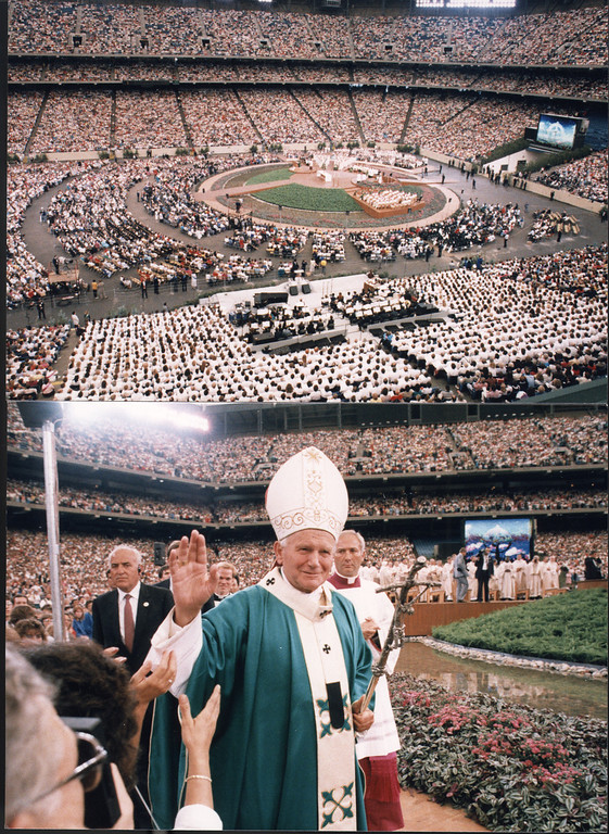 . THESE ARE PHOTOS TAKEN AT THE SILVERDOME OF POPE PAUL II IN 1987.