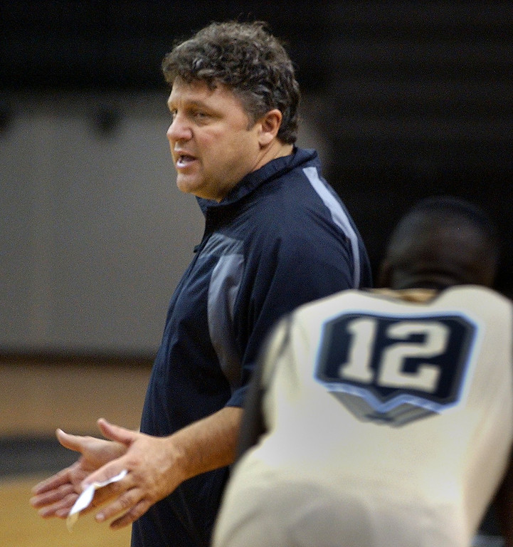 . Greg Kampe, Oakland University men\'s basketball head coach, talks to the team during practice, Thursday October 29, 2009.