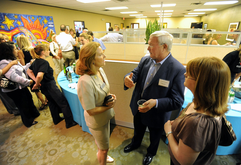. City of Auburn Hills City Council member Anne Doyle, left foreground, chats with Oakland County Executive L. Brooks Patterson, during the grand opening of the ecoStore.  Photo taken on Thursday, July 29, 2010, in Auburn Hills, Mich.  (The Oakland Press/Jose Juarez)