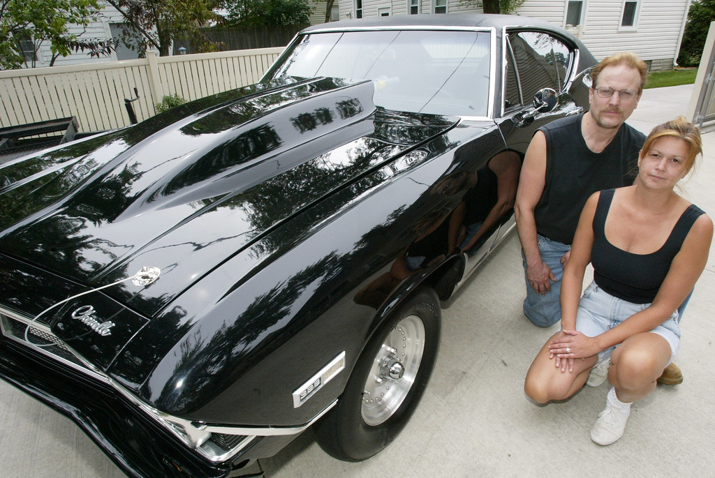 . Jimmy Weingarten and his wife Carolyn pose with their 1968 Chevelle Super Sport at their Royal Oak home. Photographed Tuesday, July 27. 2004.