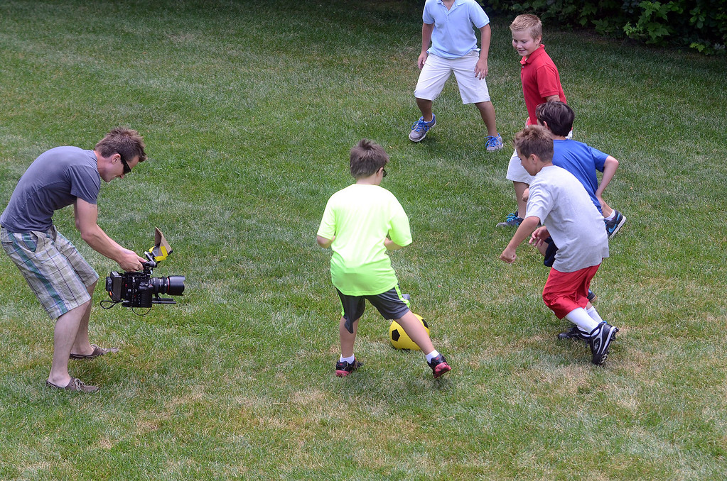 ". A soccer scene for the movie ""Papou,\"" is filmed on location at a home in Novi, Thursday July 25, 2013. (Oakland Press Photo:Vaughn Gurganian)"