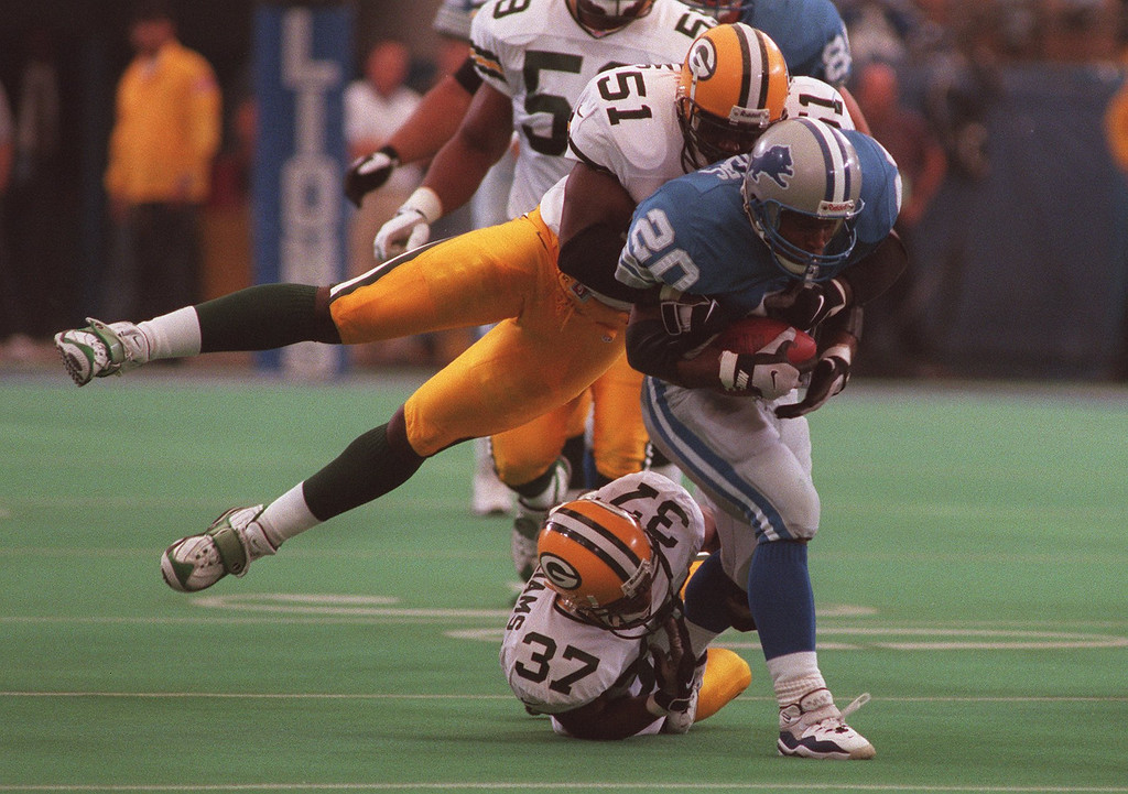 . Lions verses Green Bay; Barry Sanders had a big day running against Green Bay as #51 Brian Williams tries to bring him down. At the Silverdome.