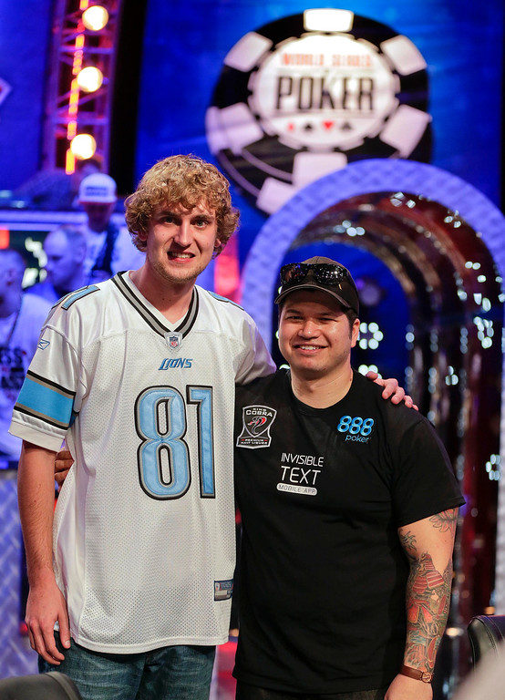 . Ryan Riess  poses for a photo with Jay Farber after advancing as the two remaining finalists during the World Series of Poker Final Table, Tuesday, Nov. 5, 2013, in Las Vegas. (AP Photo/Julie Jacobson)