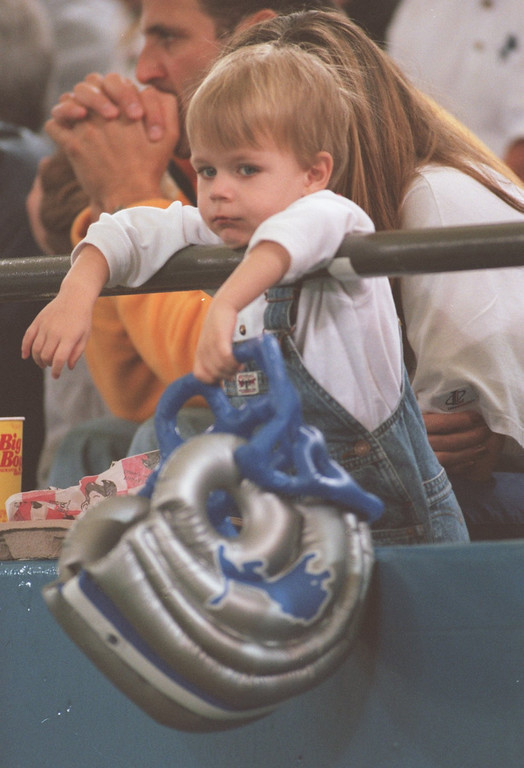 . Nicolas Cuppetilli, 3, of West Bloomfield, hangs his hat (helment), as he watches the Lions lose another.  The Arizonia Cardinals beat the Detroit Lions 17-15 at the Pontiac Silverdome.