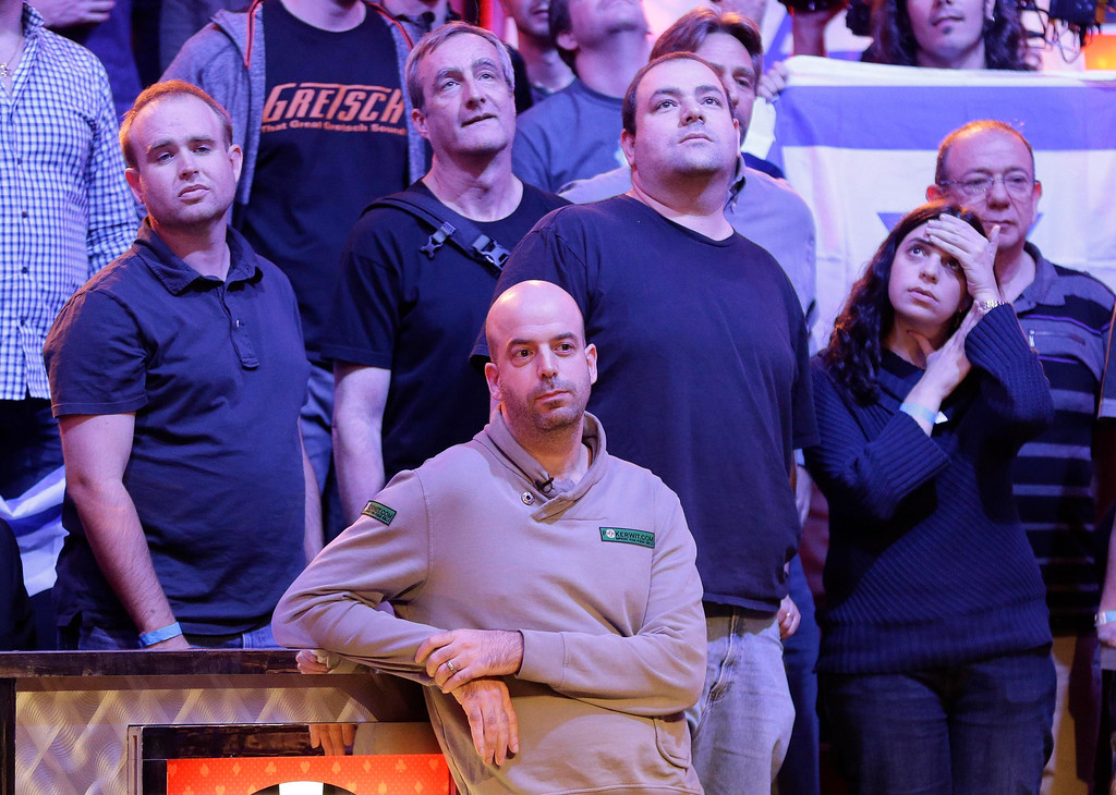 . Amir Lehavot  and his fans watch the flop after betting all in during the World Series of Poker Final Table, Tuesday, Nov. 5, 2013, in Las Vegas. Lehavot lost the hand and was eliminated from play finishing third. (AP Photo/Julie Jacobson)