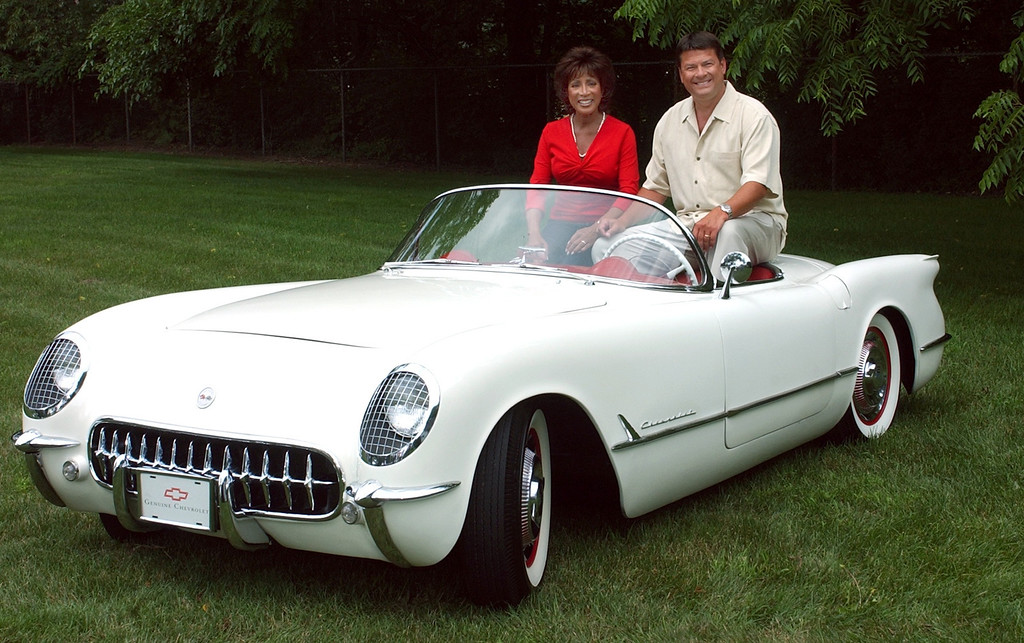 . Diane Lewis and Steven Clark both TV anchors for ABC channel 7 sit in a classic 1953 Corvette as a promo for this year\'s Annual Woodward Ave. Dream Cruise.