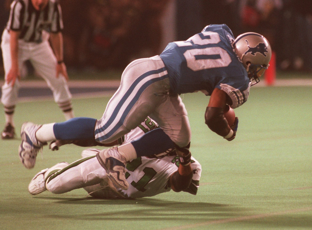 . Lion\'s running back Barry Sanders runs over NY Jets strong saftey Victor Green in the 2nd quarter of their game at the Silverdome.