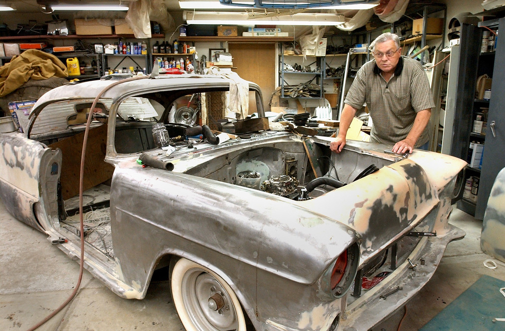 . Bob Hamm with his1955 Cheverolet Belair that he is restoring at his Waterford Township home.  Hamm can no longer drive in the Dream Cruise because a stroke damaged his eyesight.