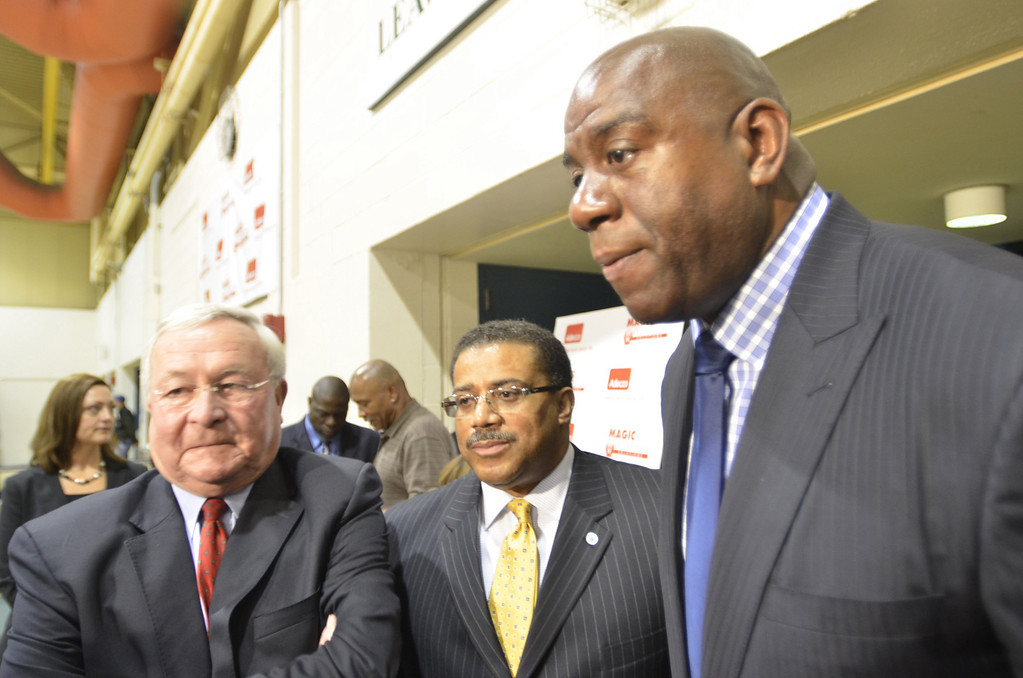 """. Earvin \""""Magic\""""  Johnson (right) spoke to students and job seekers at the Oakland Community College Orchard Ridge Campus jobs fair this morning. Johnson Controls has about 100 job openings through out the state and \""""Magic\"""" Johnson is helping promote the efforts. With Johnson is Oakland County Executive L. Brooks Patterson (left) and Victor Asante, Johnson Controls, Director of Talent for North America."""