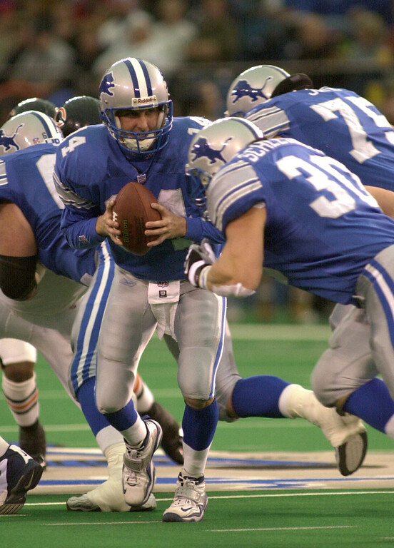 . Detroit Lions quarterback Ty Detmer (14) hands off to Cory Schlesinger (30) in the first half of action during  Sunday\'s game played at the Pontiac Silverdome on Sunday Dec. 30, 2001. The Bears won 24-0 over the Lions.