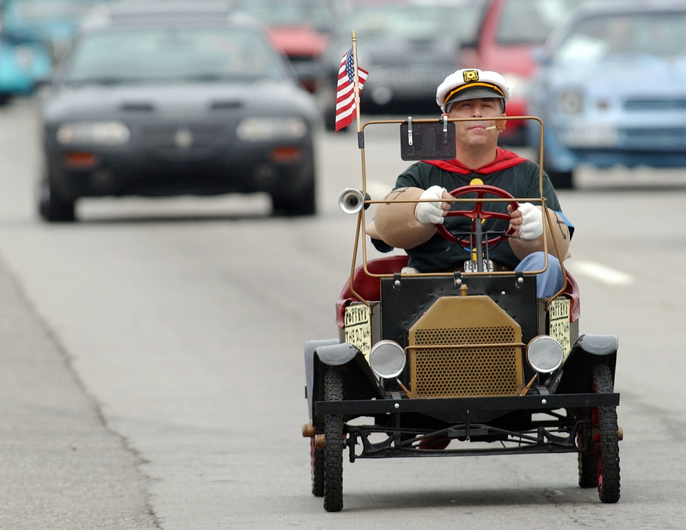 . An unidentified man, dressed in costume as Popeye the Sailor, cruises southbound Woodward Avenue during the Dream Cruise.  Photo taken on Saturay, August 20, 2005, in Royal Oak, Mich.