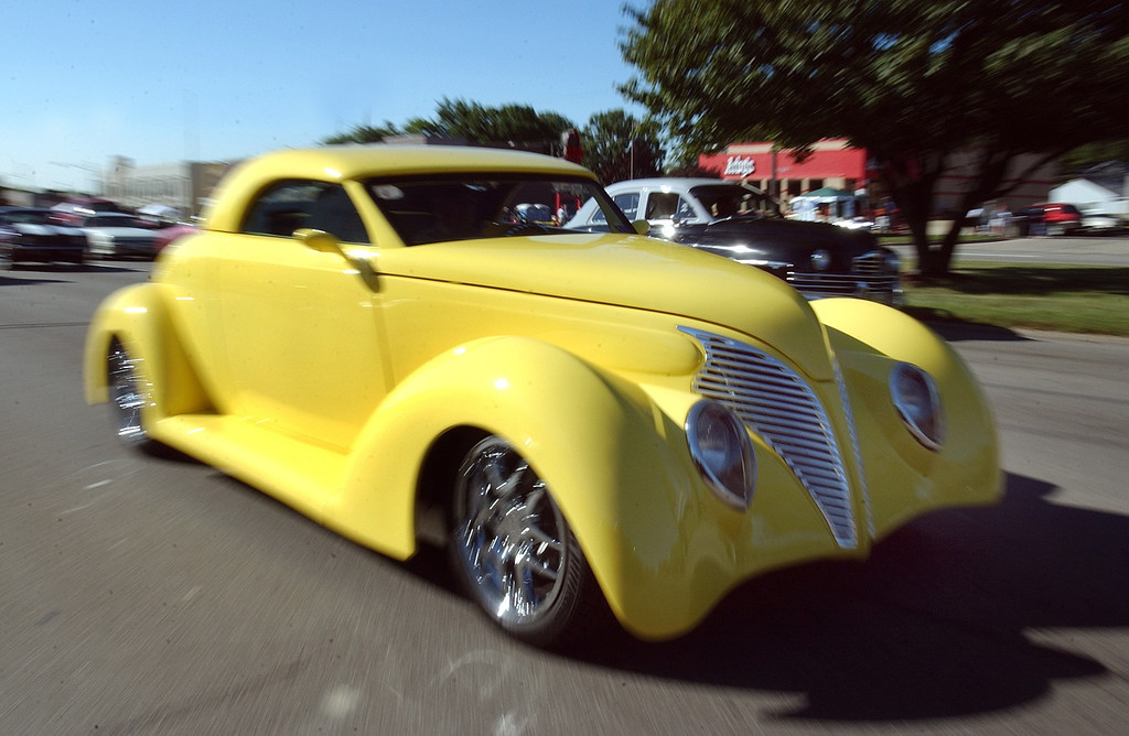 . This 1939 Ford Coast-to-Coast, owned by Tom and Carol Mason of Troy, stands out while cruising along Woodward Ave. in Royal Oak during the 2004 Woodward Dream Cruise, Saturday August 21, 2004.