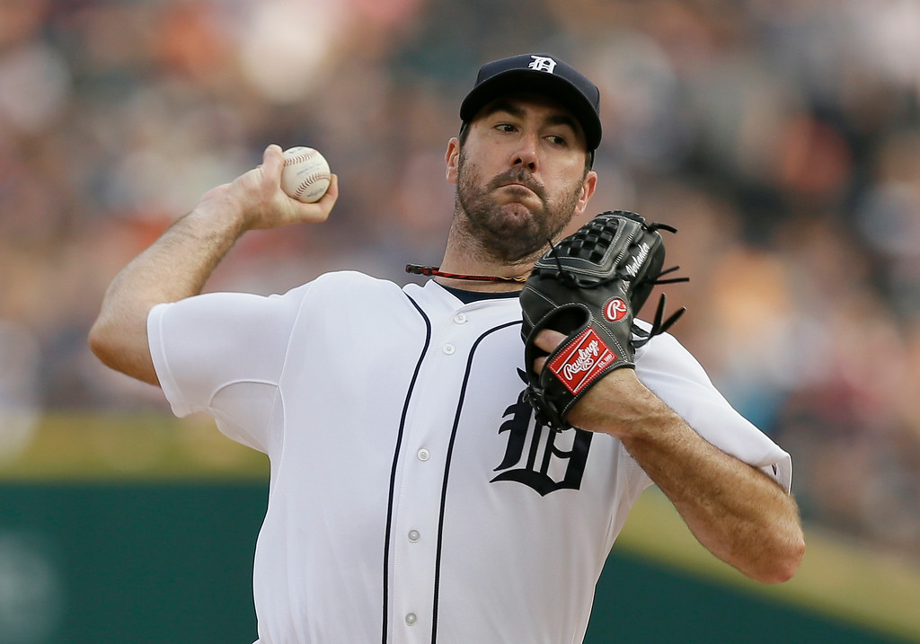 . Detroit Tigers starting pitcher Justin Verlander throws during the first inning of an interleague baseball game against the Colorado Rockies, Friday, Aug. 1, 2014, in Detroit. (AP Photo/Carlos Osorio)