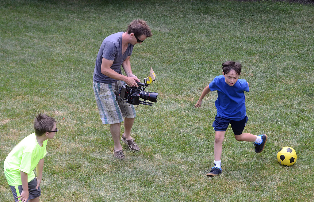 """. Evan Kole, who is the young lead in the movie \""""Papou,\"""" is filmed during a soccer scene being filmed on location at a home in Novi, Thursday July 25, 2013. (Oakland Press Photo:Vaughn Gurganian)"""