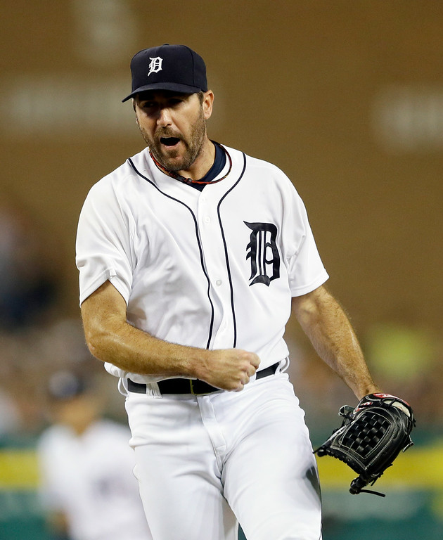 . Detroit Tigers starting pitcher Justin Verlander reacts after striking out Colorado Rockies\' Charlie Blackmon to end the seventh inning of an interleague baseball game, Friday, Aug. 1, 2014, in Detroit. (AP Photo/Carlos Osorio)