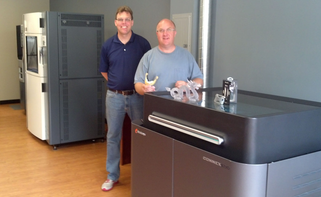 . DASI Solutions, LLC owner David Darbyshire, right, and COO Rick Darbyshire show off some of the 3-D objects printed by their company from their new showroom in downtown Pontiac. DASI specializes in the sale of 3-D printers and 3-D printing software, and also provides technical support and training. Photo by NICOLE BEATTIE/Special to The Oakland Press.
