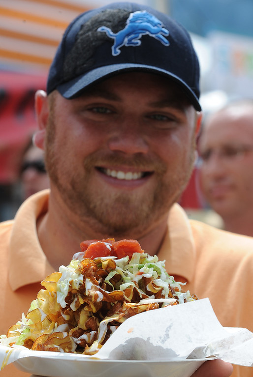 . Andy Gilbert of Sterling Heights enjoys the food at Arts Beats & Eats. (Daily Tribune/DAVID DALTON)