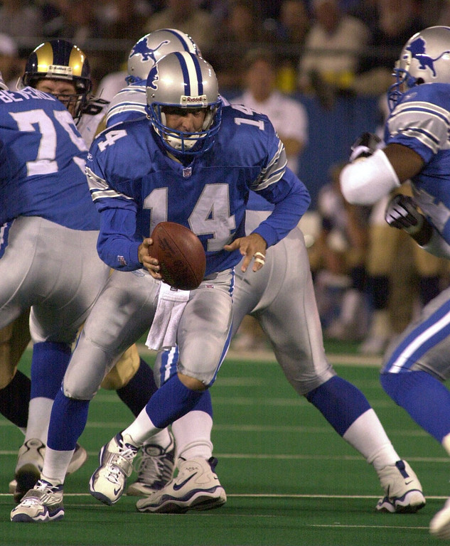 . Detroit Lions quarterback Ty Detmer (14) hands the ball off to James Jones in the first half against the St. Louis Rams played at the Pontiac Silverdome in Pontiac, Mich., Monday, October 8, 2001.