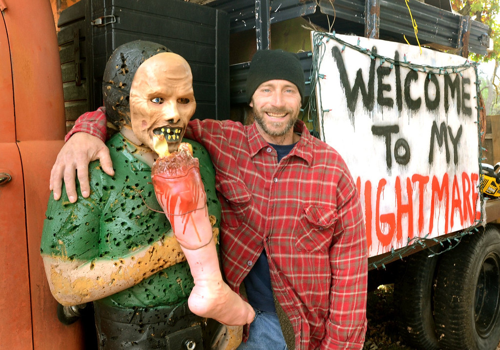 . Steven Fage with one of his buddies at his haunted yard in Waterford.  The display is on Lochaven, north of Cooley Lake Road. He has a Facebook page, Lochaven Haunted Halloween House.   Thursday, October 24, 2013.  The Oakland Press/TIM THOMPSON