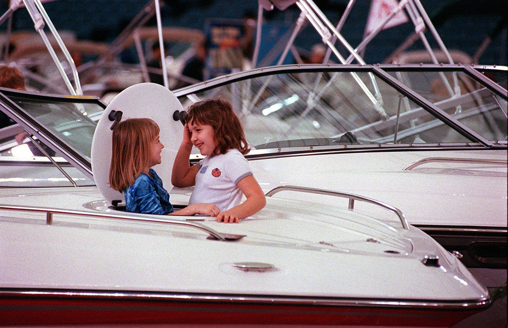 . Michigan Boat, Sport, and Fishing Show at the Pontiac Silverdome. While their parents were looking at  boats, friends Amanda Sinda and Haleigh Walgrave of Warren, Mi. did some exploring on their own only to pop up through this port hole giggling about what they found.