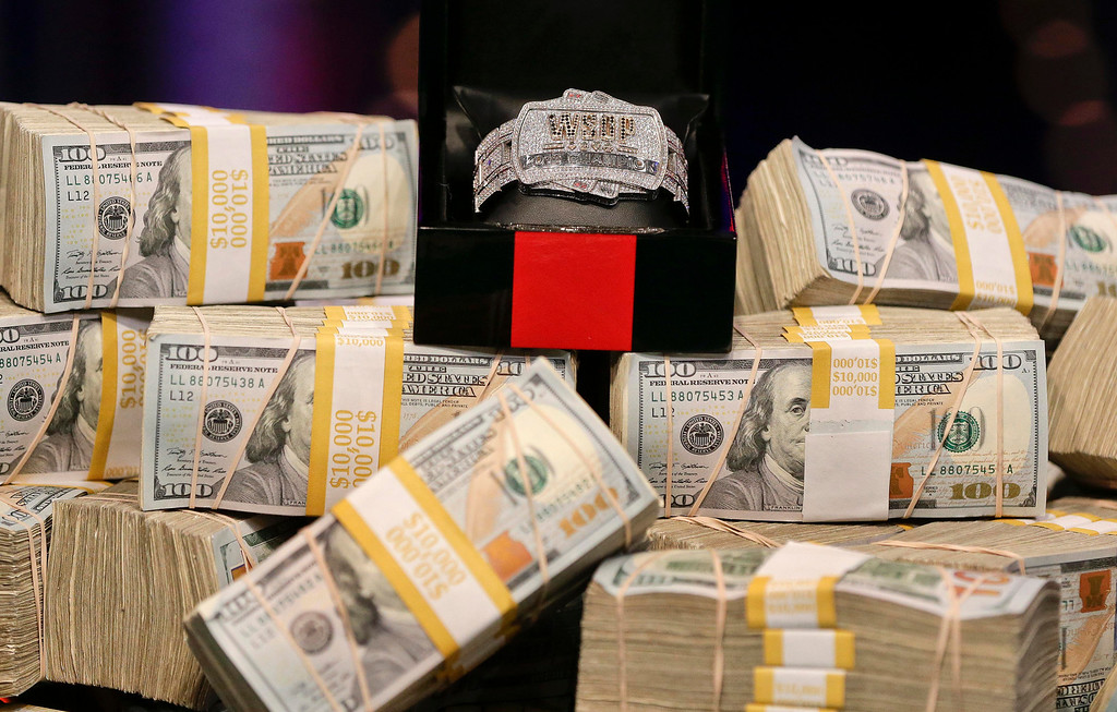 . The championship bracelet is displayed on a pile of money before the start of the World Series of Poker final table, Tuesday, Nov. 5, 2013, in Las Vegas. Two finalists remain in the game playing for an $8.4 million crown. (AP Photo/Julie Jacobson)