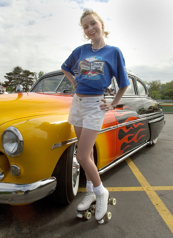 . Jennifer Secord, of St. Clair Shores, is dressed for the occasion while at the 2005 Woodward Dream Cruise kick off party at Duggan\'s Irish Pub in Royal Oak, Wednesday May 25, 2005.
