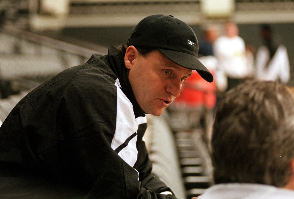 . Oakland University men\'s basketball head coach Greg Kampe talks to a reporter during practice, Thursday, November 12, 1998, at Oakland University.