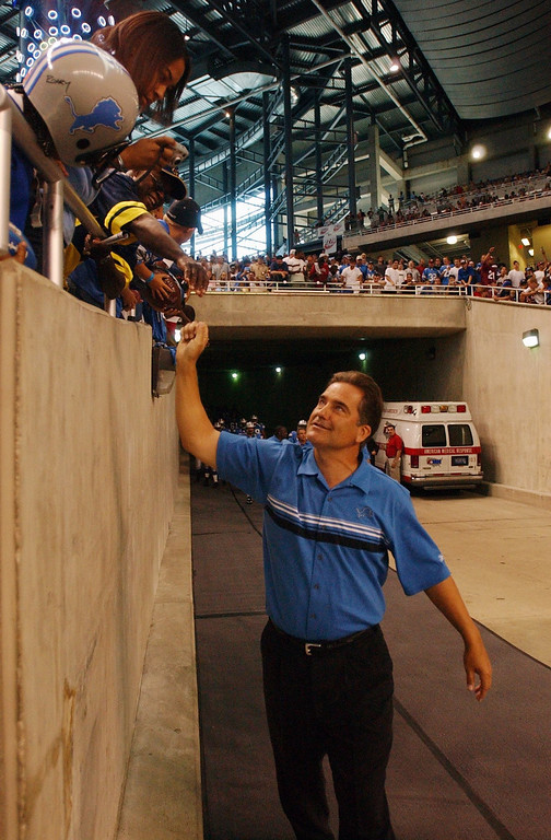 . Detroit Lions head coach Steve Mariucci shakes hands with the fans before the start of an open practice for fans at Ford Field in Detroit, Mich., Sunday, August 8, 2004.
