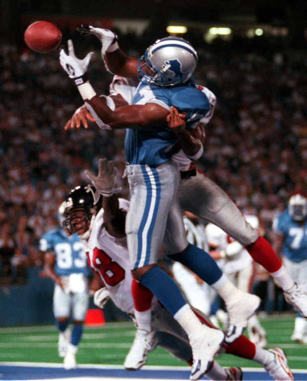 . Detroit Lions wide receiver Germane Crowell almosts get his hands on this touchdown pass in the endzone, before being taken down by an Atlanta Falcon during this August 14 preseason game at the Silverdome.