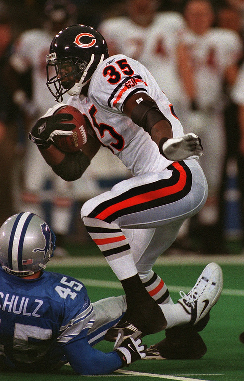 . Chicago Bears running back Anthony Thomas (right) tramples over Detroit Lions\' Kurt Schulz as he gains big yards during the Lions\' 24-0 loss at the Pontiac Silverdome Sunday. The Lions are 1-14.