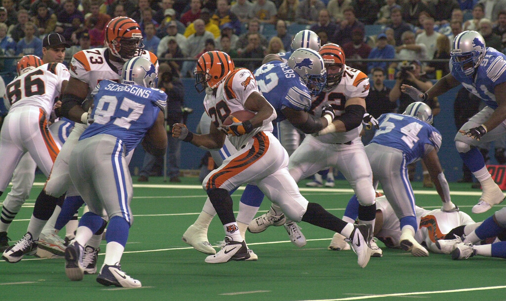 . Corey Dillion (28) of the Cincinnati Bengals runs through the Detroit Lions defence for a 96 yard touchdown run in the first quarter during Sunday\'s game played at the Pontiac Silversdome. The Lions lost 31-27 to the Bengals.