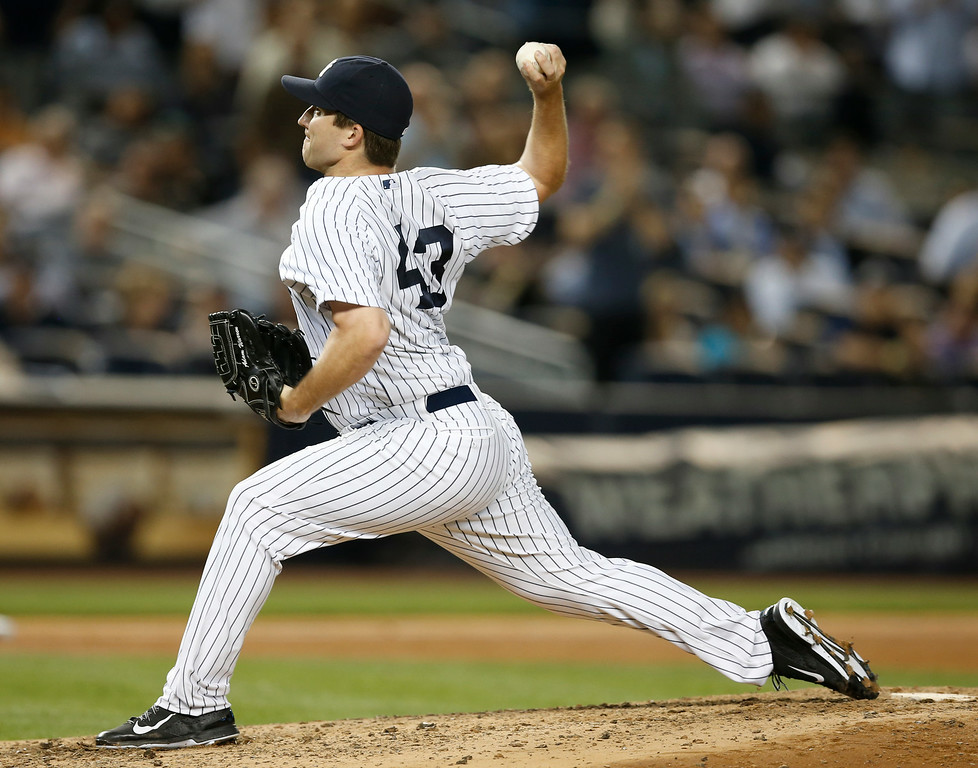 . New York Yankees relief pitcher Adam Warren (43) delivers in the seventh inning of  the Yankees 5-1 victory over the Detroit Tigers in a baseball game at Yankee Stadium in New York, Wednesday, Aug. 6, 2014.  Warren was the winning pitcher in the game. (AP Photo/Kathy Willens)