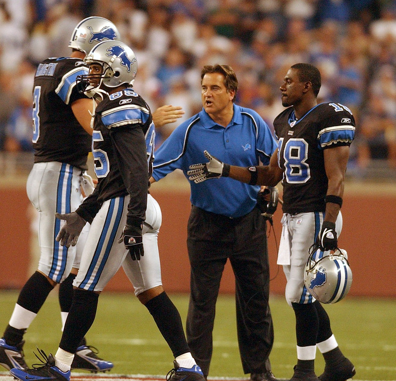 . Detroit Lions head coach Steve Mariucci celebrates with players at the end of the game after beating the Green Bay Packers during Sunday\'s season home opener to 2005 NFL season played at Ford Field in downtown Detorit on Sunday Sept. 11, 2005  The Lions won 17-3 over Packers.