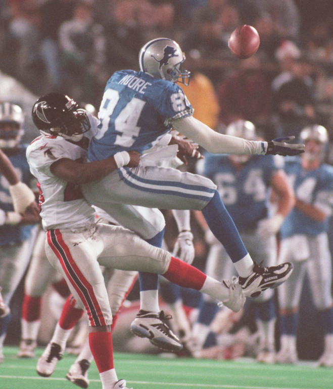 . Atlanta Falcons cornerback Ronnie Bradford gets a hold on Detroit Lions wide receiver Herman Moore. Moore had 3 catches for 34 yards.