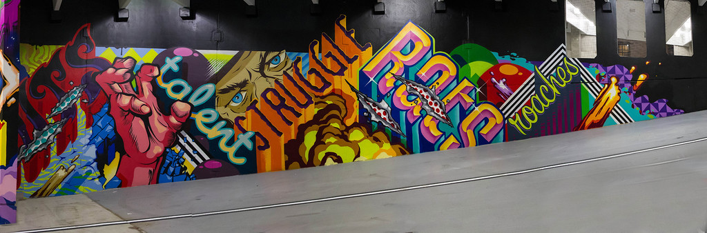 """. The ride side of a mural created by the artist know as Revok in \""""The Z\"""" parking garage in downtown Detroit."""