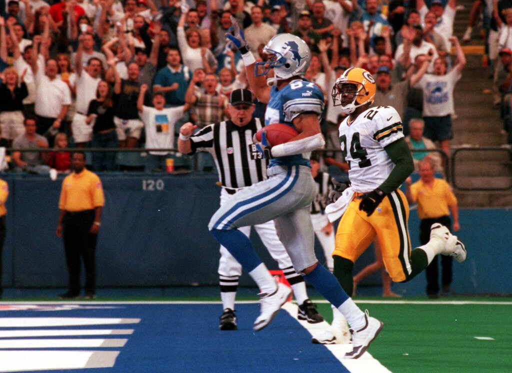 . Johnnnie Morton (87) of the Detroit Lions runs into the end zone for a touchdown in the second quarter as  Antuan Edwards (24) of the Green Bay Packers tries to catch him during Sundays game against the Green Bay Packers at the Pontiac Silverdome Lions won 23-15 over Green Bay.