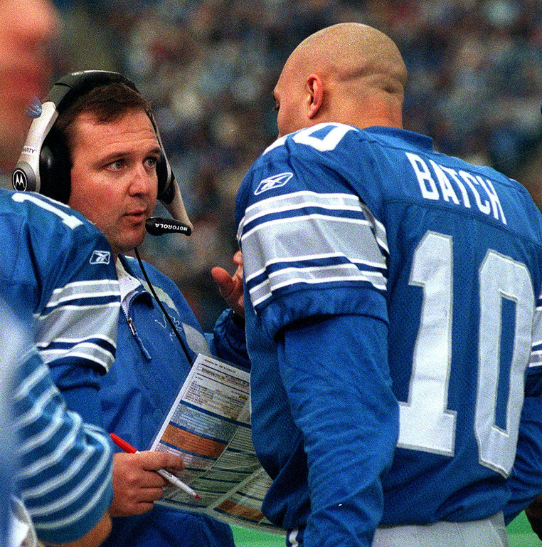 . Detroit Lions Head Coach Marty Mornhinweg (left) talks with quarterback Charlie Batch on the sidelines of Sunday\'s game against the Cincinnati Bengals at the Silverdome.