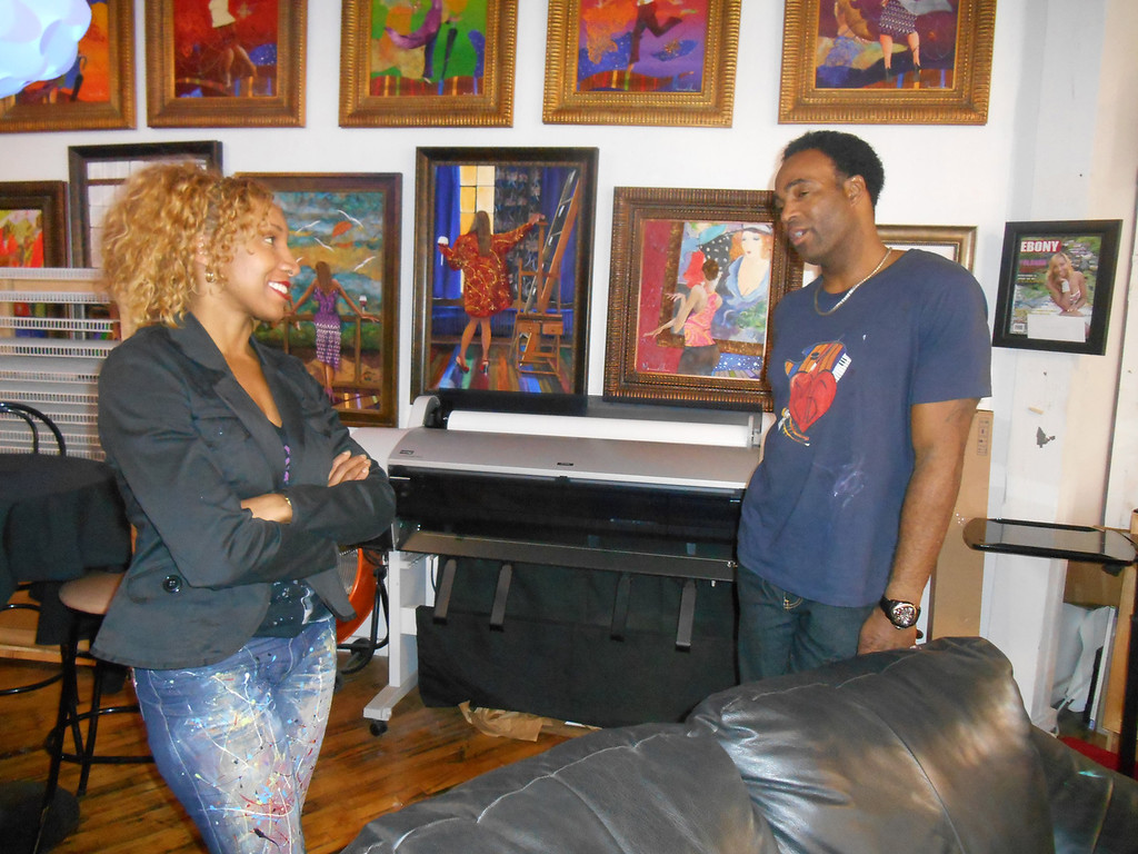 . Yolanda and Marcus Glenn talk in his studio in Corktown, Detroit. Marcus painted the jeans his wife is wearing, and the Ebony magazine cover hanging on the wall is a mockup made just for her. Photo by Nicole M. Robertson � The Oakland Press