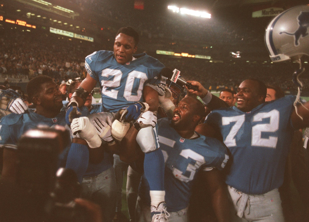 . Detroit Lions Barry Sanders is hosted onto the shoulders of fellow players after rush for 184 yards finishing the season with 2053 yards.