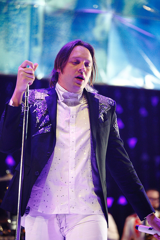. Win Butler of Arcade Fire performs at The Palace on March 10, 2014. Photo by Ken Settle
