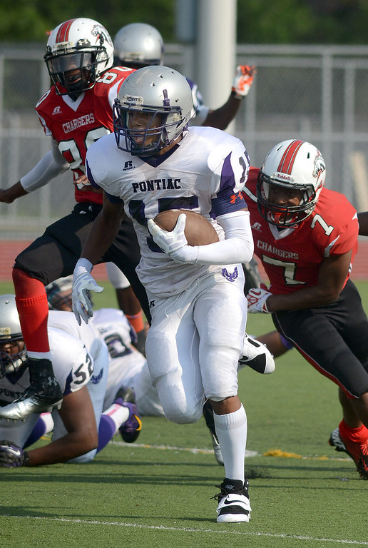. Pontiac High School\'s #15 Jamar Antwine returns a kickoff for a touchdown against Southfield-Lathrup during their game at Southfield Lathrup High School, Thursday August 29, 2013. (Oakland Press Photo:Vaughn Gurganian)