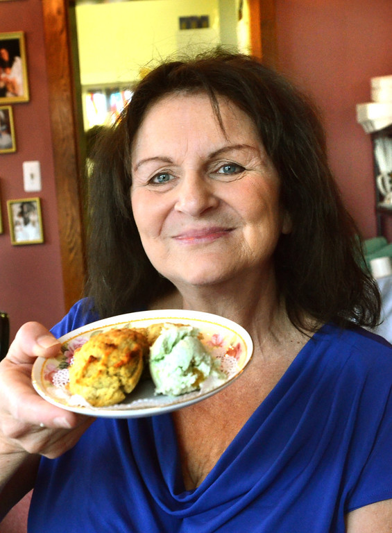 . ***WITH VIDEO***  Loretta Curry, owner of Victorian Rose Restaurant & Tea House in Rochester, with the special scones she made for the arival of the new Royal baby. The scone is a Green Pear Tea.    Tuesday, July 23, 2013.  The Oakland Press/TIM THOMPSON