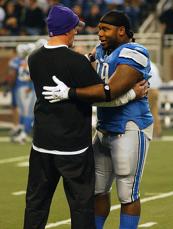 . Detroit Lions defensive tackle Corey Williams, right, greets Minnesota Vikings quarterback Brett Favre before the start of the game.  Photo taken on Sunday, January 2, 2010, in a game played at Ford Field in Detroit, Mich.  (The Oakland Press/Jose Juarez)