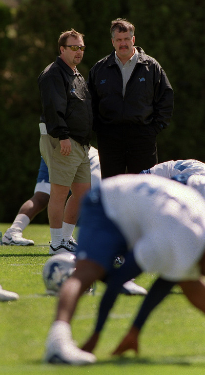 . Detroit Lions head coach Marty Mornhinweg, top left, talks with team president and CEO Matt Millen, during the Lions morning session of mini camp, Friday, April 27, 2001, at the Lions practice facility in Pontiac, Mich.