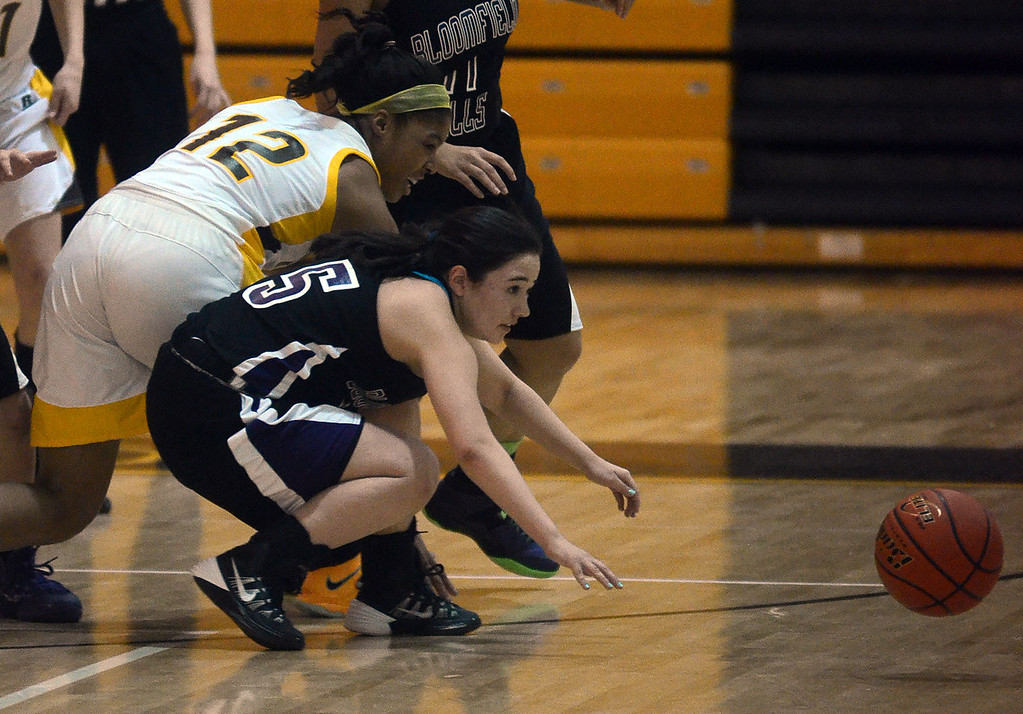 . Rochester Adams #12 Amber Jamison and Bloomfield Hills #15 Emma Hill go after a loose ball during their game at Rochester Adams High School, Thursday January 30, 2014.  Adams went on to win the game 56-50. (Vaughn Gurganian-The Oakland Press)